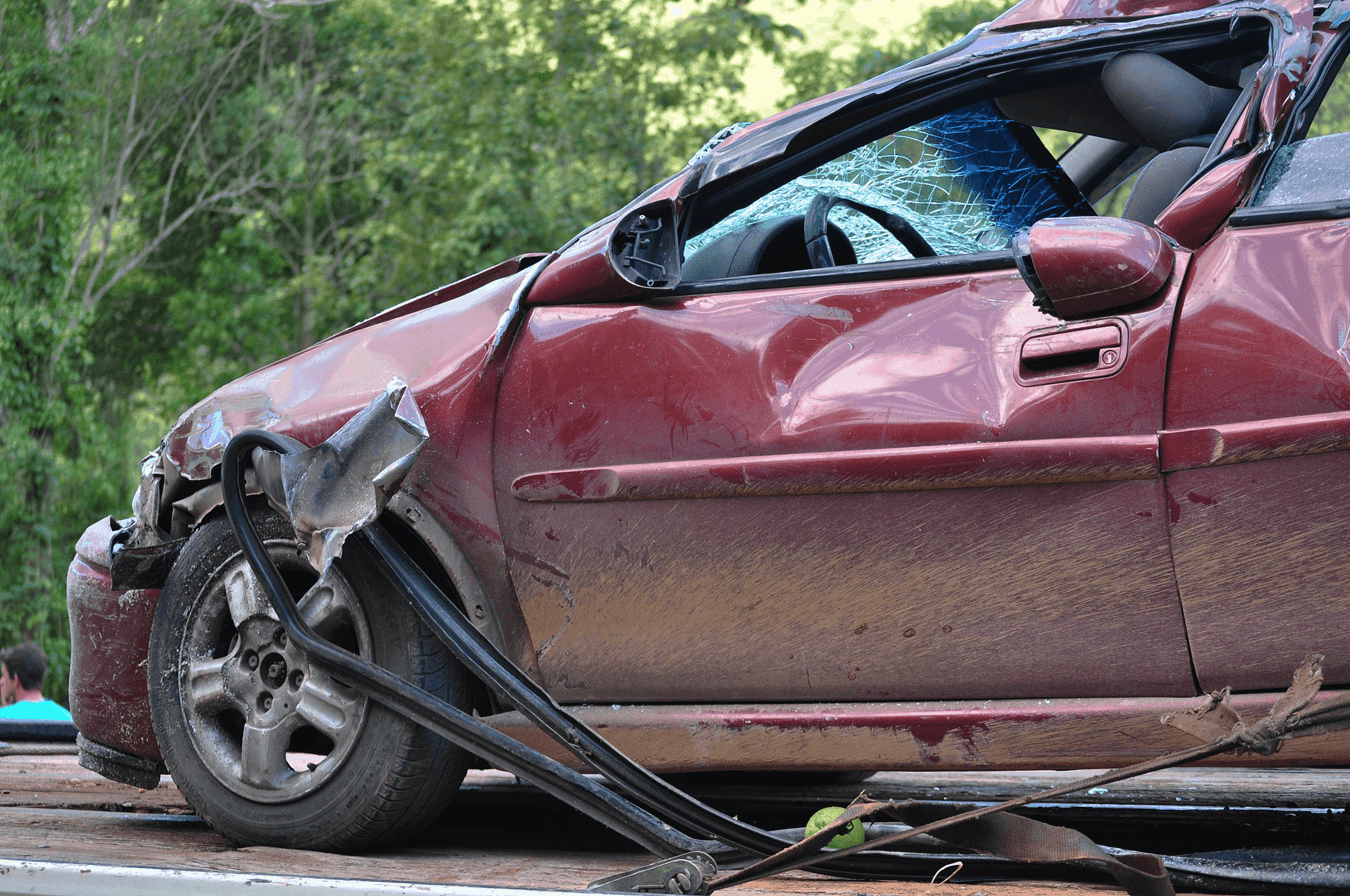Red car with smashed fender, door and windsheild